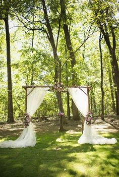 outdoor altar. I like the use of natural looking wood plus the draping.