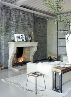 A modern dream home, the Industrial-Rustic House in Amsterdam has been cleverly designed and transformed by John Guy van Keulen, featuring layer upon layer of Home Fireplace, Brick Fireplace, Fireplace Design, Fireplaces, Brick Walls, Stone Mantle, Stone Chimney, Brick Interior, Interior Exterior