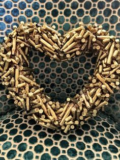 Wreath made of bullets! Recycled crafts, bullet and shotgun shell crafts, wreath ideas. Wreath made of bullets! Recycled crafts, bullet and shotgun shell crafts, wreath ideas. Shotgun Shell Art, Shotgun Shell Crafts, Shotgun Shell Wreath, Shotgun Shells, Bullet Casing Crafts, Bullet Crafts, Ammo Crafts, Hunting Crafts, Diy Crafts