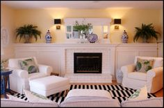 White painted brick fireplace makeover, black and white striped rug with blue and white accents The Family Room Reveal and A Story