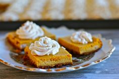 Pumpkin Cheesecake Bites--made in a jelly-roll pan; enough for a crowd. I may just sit down with a fork and eat from the middle out to the end; if you are sitting by me, I may share:) Köstliche Desserts, Delicious Desserts, Dessert Recipes, Yummy Food, Pumpkin Pie Cheesecake, Cheesecake Bites, Cheesecake Squares, Cheesecake Recipes, Pumpkin Recipes