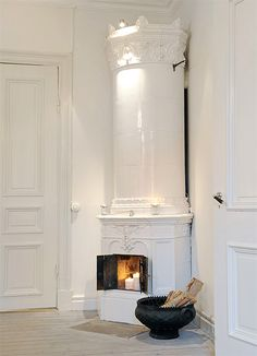 The coolest looking wood stove ever, all white and looks like you could easily DIY with the right material.