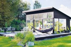 Scandinavian Chic: Dark Façades. Who else wants to be on that hammock?