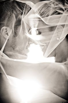 LOVE this shot through the veil. Must have photo, and so beautiful in black and white!