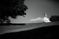Arius Photography- The Garrison-Summer Wedding - Elegant black and white of bride walking the golf course getting ready for her First Look