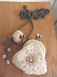 reserved  leather purse necklace ivory and lace by kikosattic