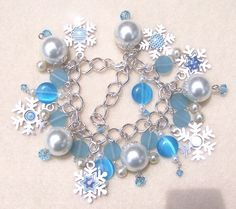Uplifting design and color scheme!  Blue Snowflake Bracelet with Removable by PaperandBeadsbyAngie, $25.00