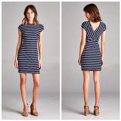 """Short Sleeve Mini Dress - Navy Short sleeve mini dress with V crossed back. Horizontal navy and white stripes and high round neckline. Material is 95% polyester and 5% spandex. Measurements laying flat (Bust, Hip, Length) - Small: 15"""", 16"""", 33.5""""; Medium: 16"""", 17.5"""", 34.5""""; Large: 17"""", 18.5"""", 35.5"""". Vega Boutique Dresses"""