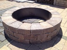 Do-It-Yourself Unilock® Fire Pit - 27 Best Fire Pit Ideas and Designs | Home DIY Tutorials by Pioneer Settler at http://pioneersettler.com/fire-pit-ideas-designs/