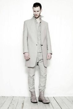 Masahiko Maruyama who is behindthe Japanese label Nude:MMcreated a delectable menswear Fall Winter 2014 collection. It is a monochromatic collection where architectural influences convolutetrendy proportions of sportswear and smart casual in a mix of wool, linen twill and nylon.