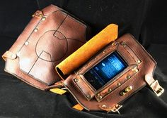 Hands-Free Steampunk Cell Phone Bracer.  I might have to try to make something like this...