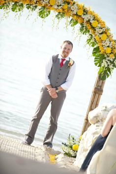 Red tie and yellow flower arch - bright and colourful combination.  Beach weddings, Koh Samui, Thailand