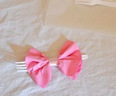 Bow Tie Napkins: The other day, I was looking for ideas for my baby shower and I came across some bow napkins for place settings and they looked so cute and easy. I decided to make them up for just a little extra something at the party. Bow Tie Napkins, Rain Baby Showers, Styling A Buffet, Ribbon Colors, For Your Party, How To Make Bows, Shower Party, Baby Shower Decorations, Baby Gifts
