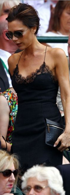 Who made  Victoria Beckham's sunglasses, black clutch handbag, and black lace dress that she wore in London on July 7, 2013?