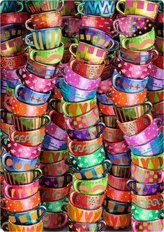 look at all these wonderfully colorful coffee cups! New cup every day....or enough to have a lot of friends over for coffee (and remember which cup belongs to which friend!)