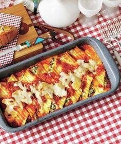 Creamy Spinach-and-Ricotta Manicotti -- add crumbled cooked italian sausage for some protein.  Auden might like this a lot....