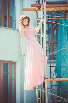Girl in a pink dress on the scaffolding by Vyacheslav  Kolomeets on 500px