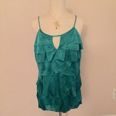 "NWT BCBG Ruffled Hem Kelly Green Sexy Cutout Tank Bright green tank by BCBG. Brand new with tags, and never worn. Has a few wrinkles from storage but can easily be steamed out. Has a flattering fit, with a cutout at bust. Tagged a size large and fits up to a size 40"" chest, 32-34 waist and is 26"" from shoulder to hem BCBG Tops Tank Tops"