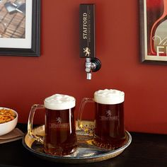 Pour a cold brew and toss it back with this great set of barware. Now giving your home drinking space a cohesive look is no problem with our custom tap handle and beer mug set.