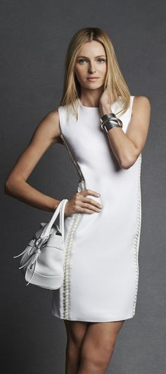 Ralph Lauren Black Label: This chic LWD features a body-hugging silhouette that is accented by edgy lambskin lace-up details along the sides.
