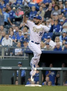 Kansas City Royals first baseman Eric Hosmer leaps to grab a throw for an out on a grounder by Baltimore Orioles' Manny Machado in the first inning during Friday's baseball game on April 22, 2016 at Kauffman Stadium in Kansas City, Mo.