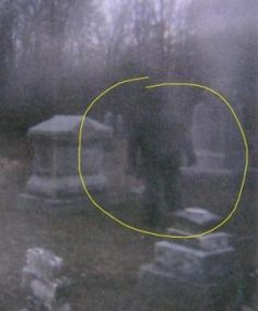 Dark man in the Peck Cemetery, taken in Decatur Ill., a well-known haunted cemetery in the area.  There were 2 people at the location at this time, but neither claim to be in this shot.
