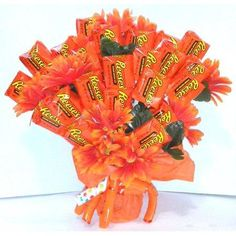 Instantly sweeten up your sweetie's day with this eye-catching and mouth-watering Reese's Peanut Butter Cups bouquet. This incredibly enticing bouquet is made of 36 delicious little peanut butter cups accented with lovely faux orange flowers. Reese's Chocolate, Chocolate Flowers, Chocolate Bouquet, Candy Bouquet Diy, Diy Bouquet, Bouquets, Valentines Flowers, Valentine Day Gifts, Valentines Baking