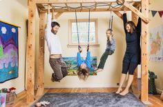 By keeping her kids' clothes and toys to a minimum and putting both beds (her kids share one) in the same room, Katy was able to free up space for an indoor jungle gym. They have no TV, no chairs & no hang-ups about their unconventional home.