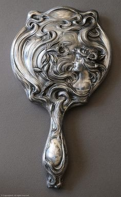 "Art Nouveau Mirror. An Art Nouveau mirror marked ""Derby Silver Co., Patented June... 1900, July 26, 1900"" The Derby Silver Company made silver plate flat and hollowware in Derby, Connecticut. They were one of the original companies that united to become the International Silver Company in 1898. They also used the name ""Derby Silver Plate Company"". This piece probably dates from 1900 to 1905 