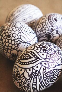 "Sharpie Easter Eggs (""Grab a Sharpie marker and doodle to your heart's content to create these doodle eggs."" Reminds me of the coloring books out right now..which would be kinda cool to incorporate)"