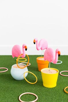 DIY Flamingo Ring Toss | How to throw a Tropical Party with these 19 DIY ideas. Have an awesome summer celebrating birthday or just the warm summer weather with bright and colorful tropical party ideas. Choose from flamingoes to pineapples add a modern touch or bring back the retro vibe with these DIY tropical party ideas! This is how you celebrate summer! #tropicalpartyideas #tropical #DIYpartyideas