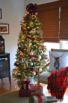A Christmas living room tree with plaid and red. | chatfieldcourt.com