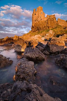Dunure Castle ruin, Ayr, Scotland by Peter Ribbeck; so old it's become the same color as the rocks