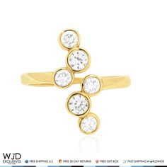 This Midi ring features six simulated white diamonds cradled in bezel setting side by side and finished in 14k solid yellow gold.Being an April birthstone white diamond makes a great gift for Aries and Taurus zodiac signs. Product Specifics   Metal 14k Yellow Gold   Style SimulatedDiamond Midi ...