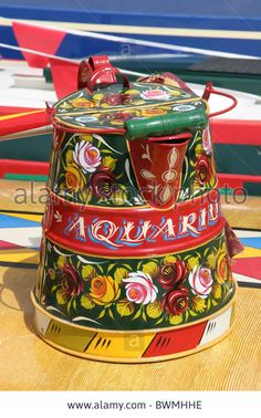 two decorated buckby can traditionaly painted with castles and roses from the narrow boat Aquarius Stock Photo Canal Boat Art, Canal Barge, Narrow Boat, Traditional Roses, Boat Decor, Watering Cans, Leather Dye, Boat Painting, Water Art