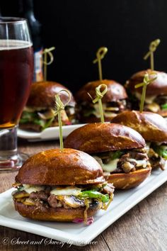 Philly Cheese Steak Sliders ~Sweet & Savory : Messy little Philly cheese steak sliders Messy little Philly cheese steak sliders are irresistibly cheesy and flavorful, perfect for your game day menu! Philly Cheese Steaks, Gourmet Recipes, Beef Recipes, Snack Recipes, Cooking Recipes, Hamburger Recipes, Barbecue Recipes, Cooking Tips, Breakfast Recipes