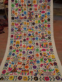 katchi textiles/vintage mirror work and patchwork wall hanging/antique/tribal textiles. $79.00, via Etsy.