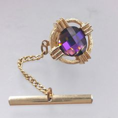 Check out this item in my Etsy shop https://www.etsy.com/listing/512669751/purple-rhinestone-tie-tack-square-cut