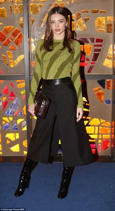 Covered up: Miranda Kerr was dress more appropriately for the season as she teamed a striped green jumper with a long black culottes and shiny black boots Miranda Kerr Dress, Estilo Miranda Kerr, Miranda Kerr Style, Classy Outfits, Fall Outfits, Casual Outfits, Fashion Outfits, Fashion 2020, Love Fashion