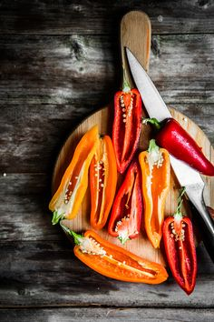 Colorful peppers on rustic background by Alena Haurylik - Photo 114517087 - 500px