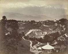 """View of Darjeeling from St. Paul's School taken in the 1870s. """"Darjeeling was part of the territory of the Rajas of Sikkim till the 18th century and was given to the British in 1835. The British built a sanatorium here and it soon became the summer headquarters of the Bengal government. This is a general view overlooking the town, looking north towards Sikkim and the Himalayas, with the peak of Kanchenjunga visible in the far distance."""""""