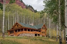 Situated in Colorado's Crystal River Valley, the home is built of skip-peeled lodgepole pine logs. A hot tub is embedded into the river rock portion of the tiered porch and deck system gracing the home's front and side.
