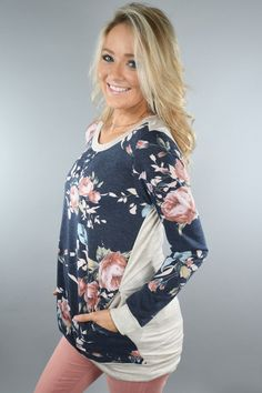 An adorable top with floral body and ivory accents. True to size. Model is 5'5'' a size 1 wearing a small. Material: 85% polyester, 10% Rayon, 5% Spandex Product Sizing Chart Size Bust Hip Length Wais