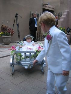 has anyone decorated/ made a wagon for their fg and rb?? :  wedding Ringbearer Pulling A Wagon