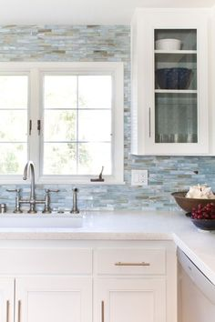 minuet quartz countertops - Love the countertops, bridge faucet ( but in chrome) Love the backsplash- but would maybe be a bit brighter blue with less brown.  Don't like the cabinet pulls.