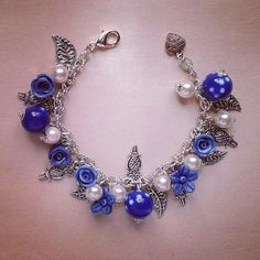 Intense blue bracelet with flowers in polymer clay  on Etsy € 15,00
