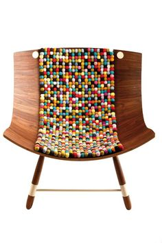 This beautiful eco chair made of walnut and felt balls.This item may be purchased on ecofirstart.com