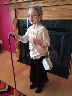 100th Day of School! Old lady makeup, peals, glasses, walking cane, grey hair in a low bun, and long velvet skirt....
