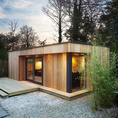 This wooden 'eco' garden room from Westbury Garden Rooms is a great contemporary option for those in an urban area, or with a more modern house. The cedar-clad room is free-standing with a grass roof, and best of all is unlikely to need planning permissio Eco Garden, Wooden Garden, Home And Garden, Garden Ideas, Quick Garden, Garden Modern, Garden Lodge, Garden Cabins, Summer House Garden