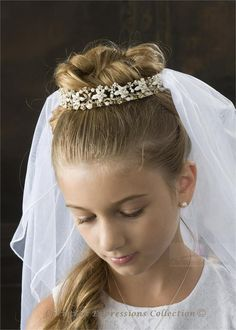 First Communion hair. Elizabeth has a tiara veil